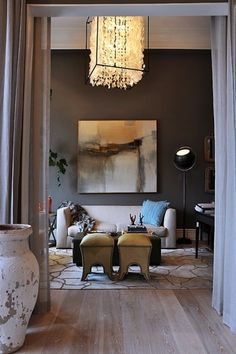 Abstract painting shows beautifully on chocolate wall...(Dark Walls Inspire!)
