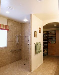 No curb and no door makes this shower very easy to use for anyone, but especially for a wheelchair-bound person. Description from flickr.com. I searched for this on bing.com/images