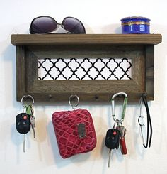 This key holder features a barnwood shelf unit, with a fabric insert. This piece measures approximately 14 x 6 1/2 x 3 1/2 thick. $34.50