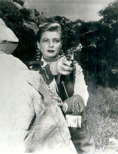Annie Oakley.  She used to have a tv program on Saturday mornings... I always thought I wanted to be her.  Long blonde hair in braids.... so cool., and she carried a gun, wore a cute hat and a skirt with cowgirl boots.
