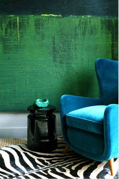 This colour combo is amazing - Costas Picadas. Just makes me smile, this neat juxtaposition of rugged green wall and soft velvet blue with pop of black and white.