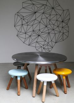 milking stools and table with colored spun metal tops