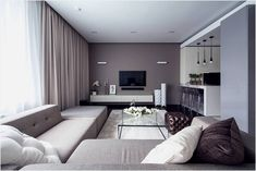 Part of the residential complex Sparrow Hills in Moscow, this apartment is characterized by a minimalist contemporary style. By improving its 60 square meter surface, designer Alexandra Fedorova managed to convey a brilliant and spacious lodging, in a very elegant manner. The shading palette was kept straightforward, made just out of neutral tints, for example, white, light gray, charcoal gray for a special accent wall. Dark wood flooring finishes the shading plan, adding a fascinating…