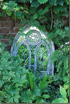 I need a garden mirror for my new house! Time to hit the flea markets....Gothic