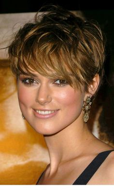 Keira Knightley sporting a short cropped haircut with extra long bangs that schroud the eyes in a curve. Description from mikail.rocks. I searched for this on bing.com/images