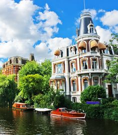 Beautiful mansion on a canal in Amsterdam. Netherlands   |   Amazing Photography Of Cities and Famous Landmarks From Around The World
