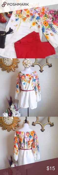 Vibrant Floral Top Excellent to like new condition. Worn once. Really gorgeous blouse. Colors are vibrant. No stains or holes. From a smoke free home. 100% Polyester Bust 25, L  28, Sleeve 20 ( 3/4 ) Key hole at the back.Bottom of the sleeves can be stretched. Relax fit. Not stretchable. Semi sheer.  Price firm ladies unless bundled. Forever 21 Plus Tops Blouses