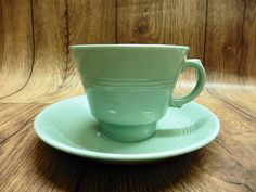 Beautiful vintage Woods Ware Beryl tea cup and saucer, in the iconic ribbed green utility ware made by Wood and Sons.  In excellent vintage condition,