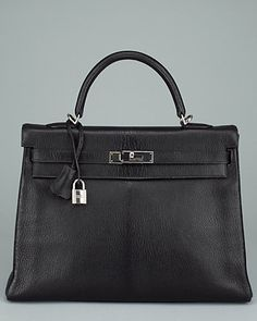 My dream bag:  Hermes Black Chevre Leather Retourne  Kelly 35cm done in black chevre leather with palladium hardware Fold-over flap with palladium turnlock closure One interior zippered pocket and two interior slip pockets Date stamp: E in a square Measurements: 13.5in long x 5.25in wide x 9.5in high; 3.88in handle and 17in shoulder strap