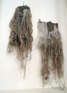 fibre art. soft, messy and haphazard. sense of unravelling, crimped fibres