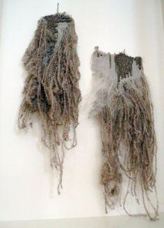 fibre art. soft, messy and haphazard. sense of unravelling, crimped fibres