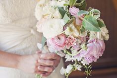 pink and green peony and ranunculus bouquet