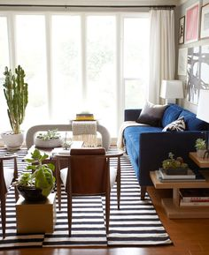 Black-and-white striped IKEA rug in elegant living space with blue sofa