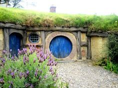 HOBBIT HOUSE. With a cheating door, BUT, it's a hobbit house...Happy sigh...