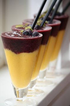 A delicious recipe for a Layered Blueberry and Mango Smoothies made with mangos and blueberries
