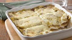 A layered tortilla, pulled pork casserole rich with green chile enchilada sauce and sour cream.
