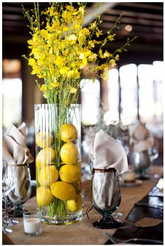 Oncidium orchid goes by the common name Dancing Lady Orchid + Lemons for a centerpiece
