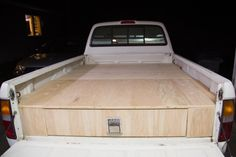 The frame is filled with a wooden box, which is the size of the bed of the truck.