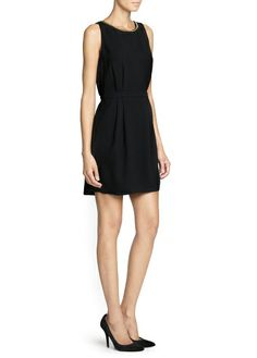 Black dress with gold necklace by Mango 2014