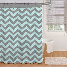 The Ryder shower curtain features a dynamic chevron repeated design accented with a solid color header. This modern design is printed an easy-care microfiber fabric in a trendy combination of aqua blue and grey.