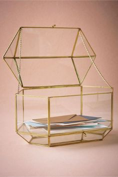 We love pieces that can be used both on your wedding day and long after! This multi-use glass conservatory has two compartments, the top perfect for collecting guests' cards and the mirrored bottom for filling with flowers or confetti; it can also be used as a centerpiece for your sweetheart table!