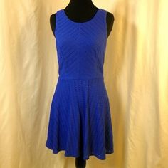 City Triangles Sleeveless Dress Short blue dress with tiny circle cutouts. Lining: 100% Polyester / Exterior: 63% Polyester 35% Rayon. City Triangles Dresses Mini