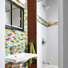 small remodeled bathroom with colorful glass tiles // colorful way to start the day with @ThisOldHouse
