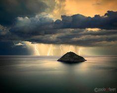 A mighty thunderstorm off the Ligurian coast near Bergeggi, Italy.