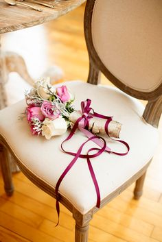This beautiful wedding flower bouquet is so beautiful, with the colored ribbons that match the arrangement to tie everything together