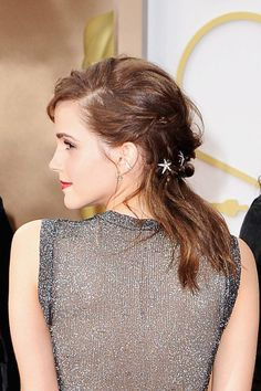 Best Beauty Looks Oscars 2014 - Emma Watson The presenter adds a whimsical touch to her twisted and tousled half-up, half-down 'do with a few star-shaped hair adornments.