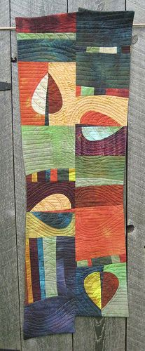 Love the color, design, and quilting of this, though I find the irregular shape of the quilt itself a bit distracting.