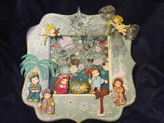 A nativity wooden frame using Magnolia Stamps. I hand drew and pieced the palm tree. See it on my blog:)