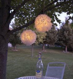 "Pom Pom light made from trash. Made from 2 dome lids from ""to go"" cups, glued together, then covered in double-sided tape.  Cute plastic bag (grocery bag or even tissue paper) into 2"" squares and attach center of each piece to the ""dome ball"" using a pencil.  Put LED tea light inside."