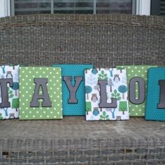 Canvas covered in scrap book paper then painted letters   TAYLOR