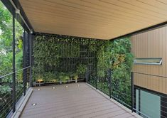 Three-Story Interior Green Wall Breathes Life into Home