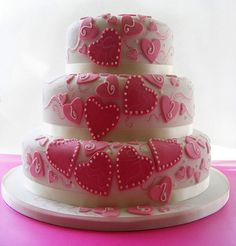 Groovy three tier wedding cake design, decorated with pink hearts and white satin ribbon. From Sarah888 www.flickr.com  ........   #wedding #cake #birthday