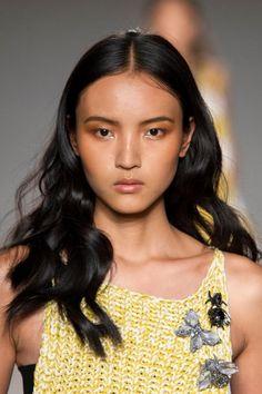 golden luminous skin, moisturised slightly glossy lips, peach bronze shadow and flushed cheeks