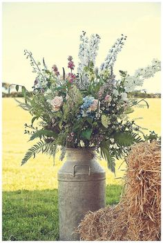 Devon wedding flowers in churn / http://www.deerpearlflowers.com/rustic-country-milk-jug-wedding-ideas/