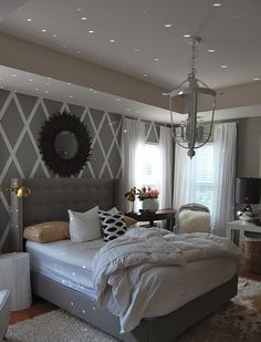 I want this -Grey bedroom, upholstered bed, white bedding, patterned wall. One dreamy bedroom!