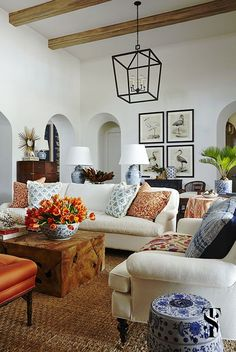 Naples Florida interior design by Summer Thornton | great room with audubon prints, chinese ginger jar lamps, wood beams and white linen sofas | Interior by Summer Thornton Design | www.SummerThorntonDesign.com