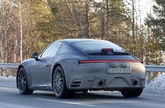 The next 911 takes its styling cues from Porsche's Mission E concept. It also features a horizontal brake light spanning the entire width of the car.