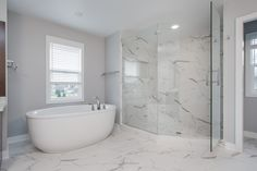 Owner's Suite: Ceramic tile floors, matching ceramic tile shower with glass door, free standing soaking tub