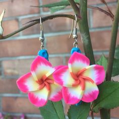 A personal favorite from my Etsy shop https://www.etsy.com/listing/290907799/large-plumeria-earrings-pink-flower