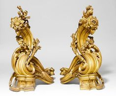 <B>PAIR OF FIREPLACE CHENETS,</b></i>Paris, Louis XV style, 19th century.<br>Bronze. Volute-shaped, decorated with leaves and flowers. H 63 cm. <br> <B>1 PAAR GROSSE KAMINBÖCKE,</b></i> Paris, Louis XV-Stil, 19. Jh.<br>Bronze. In Volutenform mit Blättern und Blumen. H 63 cm. <br>