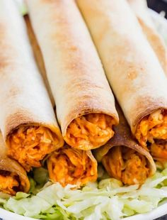 Meet your new favorite appetizer: Baked Buffalo Chicken Taquitos. Made with shredded chicken, buffalo sauce, ranch seasoning and mozzarella cheese, these are a quick and delicious way to become the most popular person at the party! Ham Rolls, Buffalo Chicken Wraps, Chicken Taquitos, Mexican Food Recipes, Ethnic Recipes, Mexican Dishes, Appetizer Recipes, Appetizer Party, Snacks Recipes