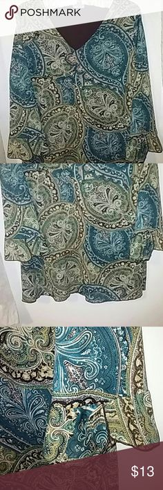 Just In💋Julie's closet USA This long sleeve blouse with green and blue Paisley's design has an inside lining shown in last picture which gives great coverage. At the end of the sleeves are slight Ruffles showing in pictures period No Tag anywhere telling what the material is, or size, but I assume it's polyester and spandex although it's not as smooth and Light as the other blouses. Medium-to-large, with a Slight V neck. Inside brown lining. Julie's closet Tops Blouses
