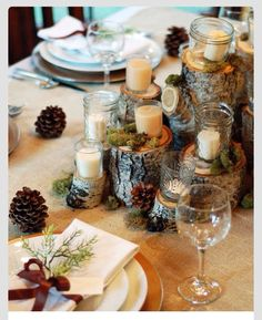 Wood, candle, and pinecone, rustic centerpiece. Perfect for a fall fest, or a Maine wedding!