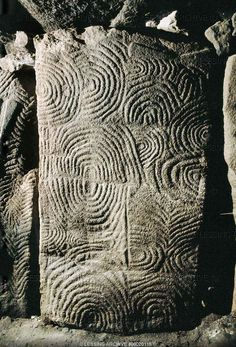 Gavrinis Tomb, c.3,500 BCE. Gavrinis (Breton: Gavriniz) is a small island, situated in the Gulf of Morbihan in Brittany, France. It contains the Gavrinis tomb, a megalithic monument notable for its abundance of megalithic art in the European Neolithic.