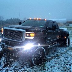 Black lifted GMC Sierra truck. www.CustomTruckPartsInc.com is one of the largest Truck accessories retailer in Western Canada. Toll Free 1-855-868-8802