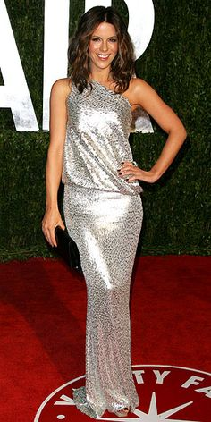 Kate Beckinsale    WHAT SHE WORE    Beckinsale put a modern spin on Old Hollywood glamour in a slinky silver Kaufmanfranco gown; she completed the look with a patent clutch and a chrysoprase, rock crystal and diamond feather ring from Julia Cohen